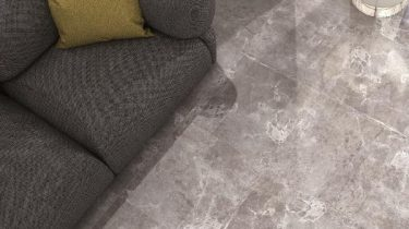 Temptation_Grey_Marble_Effect_Floor_Tiles_in_Living_Room_with_Grey_Couch_grande